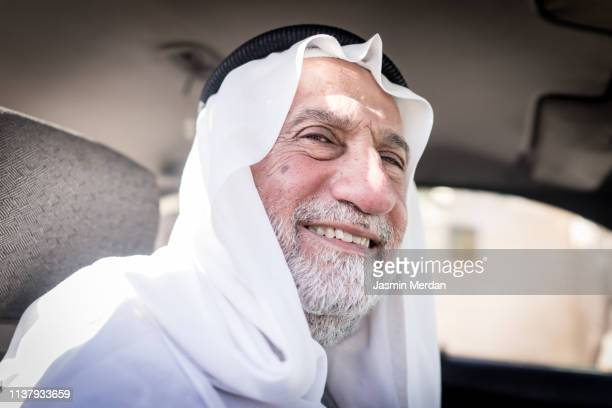 senior man in car - arab old man stock pictures, royalty-free photos & images