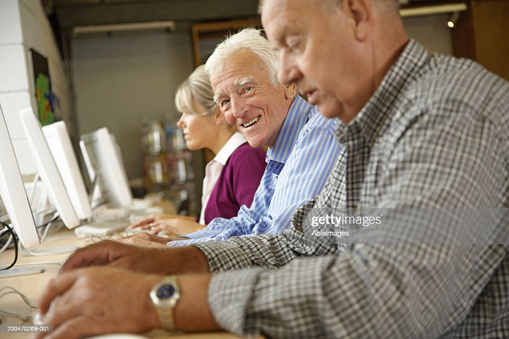 """Senior man in computing class, smiling, portrait"" : Stock Photo"