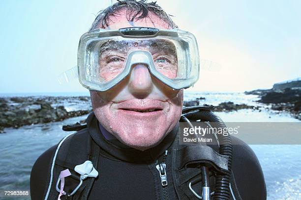 senior man in diving goggles by sea, portrait - wide angle stock pictures, royalty-free photos & images