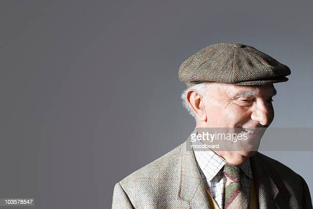 senior man in flat cap, head and shoulders, in studio - tweed stock pictures, royalty-free photos & images