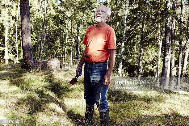 senior man in forest - archipelago stock pictures, royalty-free photos & images