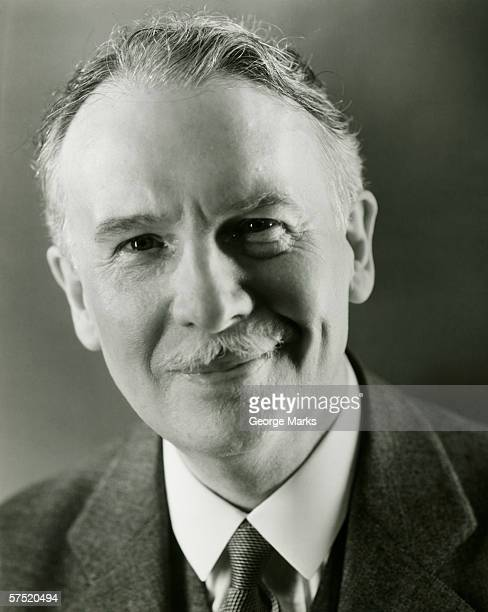 senior man in full suit smiling, (b&w), portrait - 20th century stock pictures, royalty-free photos & images