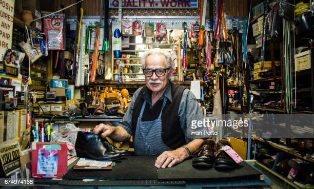 senior man in his shoe repair shop. - retail occupation stock pictures, royalty-free photos & images