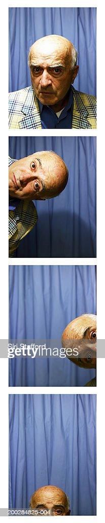 Senior man in photo booth : Stock Photo