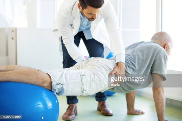 senior man in physical rehab. - rheumatoid arthritis stock pictures, royalty-free photos & images
