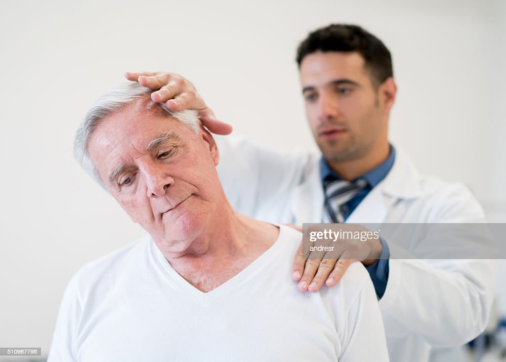 Senior man in physiotherapy : Stock Photo