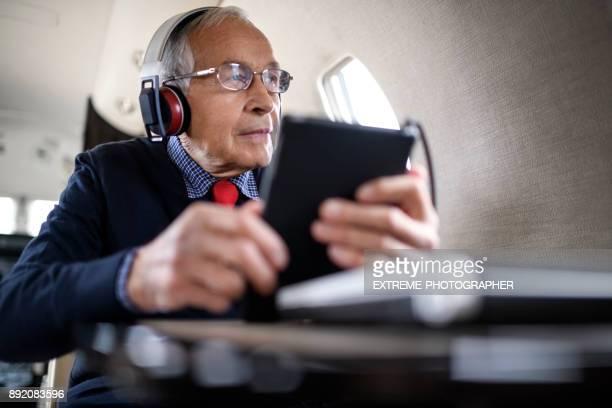 Senior man in private jet airplane