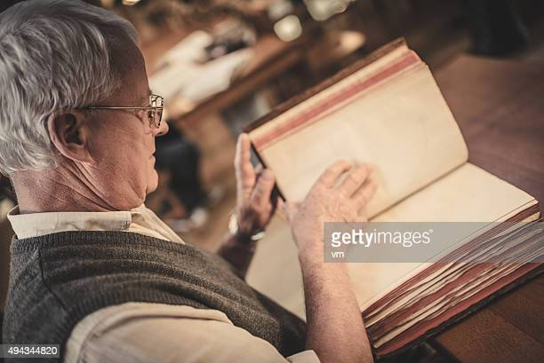 Senior man in public library