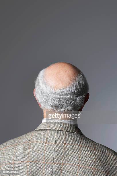 senior man in studio, head and shoulders, back view - head stock pictures, royalty-free photos & images