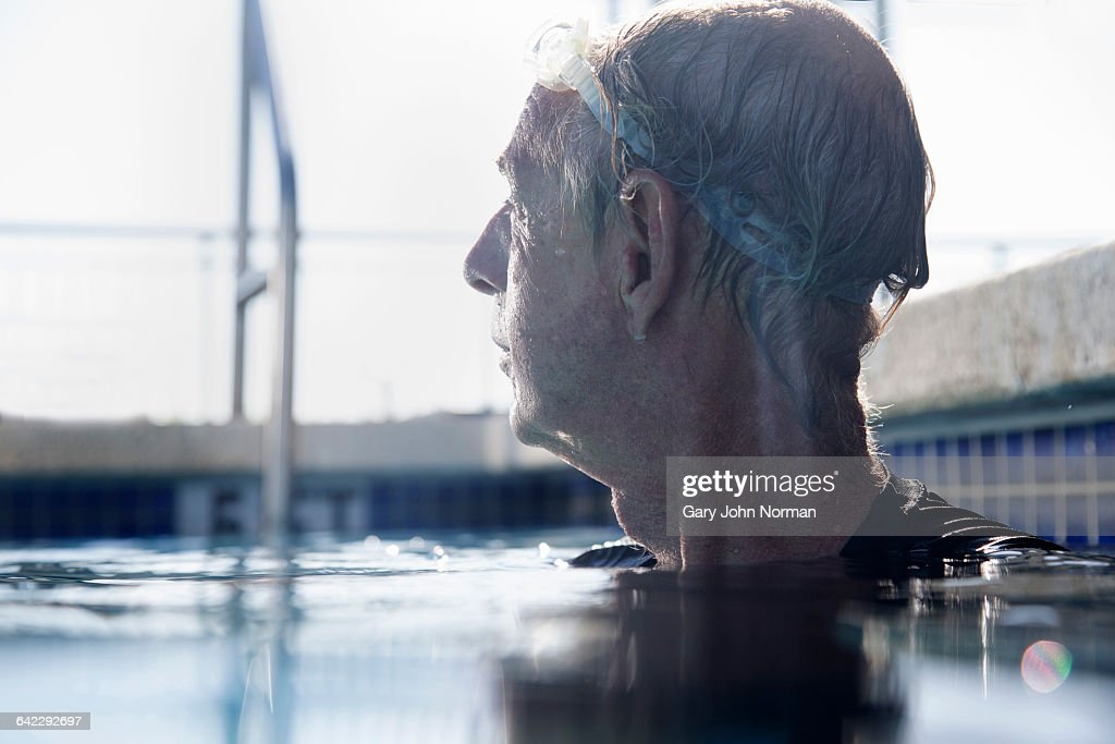 Senior man in swimming pool : Stock Photo