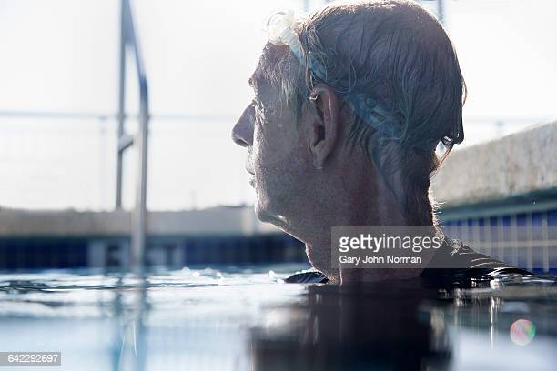 senior man in swimming pool - norman elder stock photos and pictures