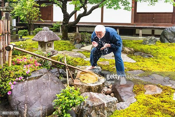 Senior man in temple garden