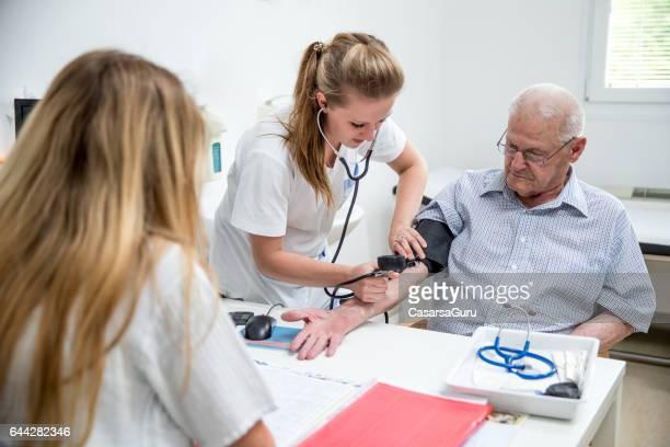 Senior Man In The Elderly Center Is Visiting The Doctor