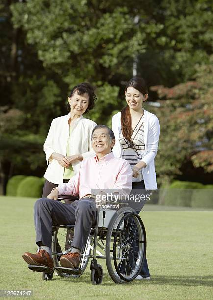 Senior man in wheelchair and family