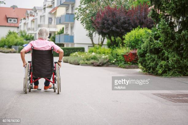Senior man in wheelchair, enjoying a day in the city