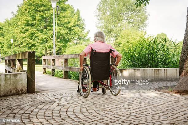 Senior man in wheelchair, enjoying a day in the park