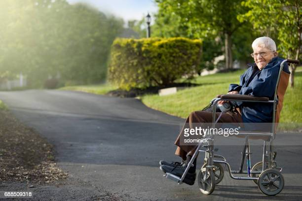 senior man in wheelchair enjoying spring day - copd stock photos and pictures