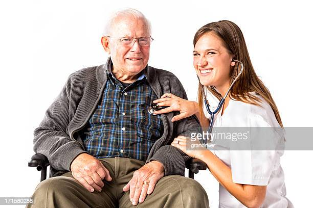 senior man in wheelchair with nurse - nurse and portrait and white background and smiling and female and looking at camera stock pictures, royalty-free photos & images