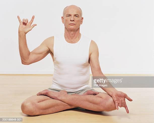 Senior man in yoga 'wisdom' position, portrait