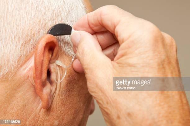 Senior Man Installing Hearing Aid