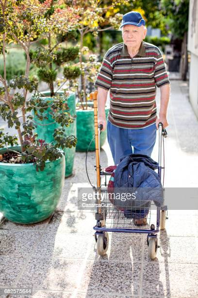 Old Man Walking Frame Stock Photos and Pictures | Getty Images