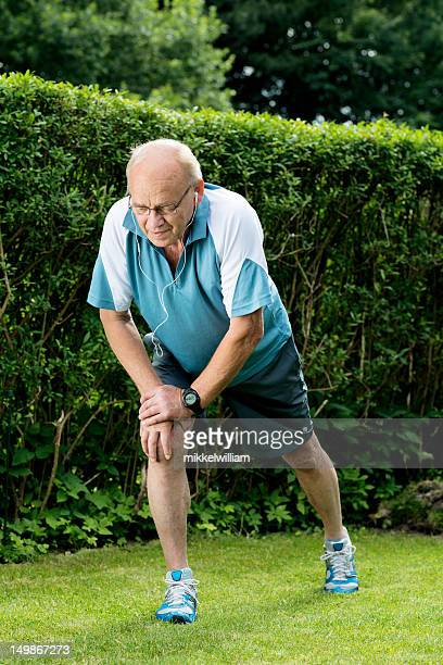 Senior man is stretching before going for a run