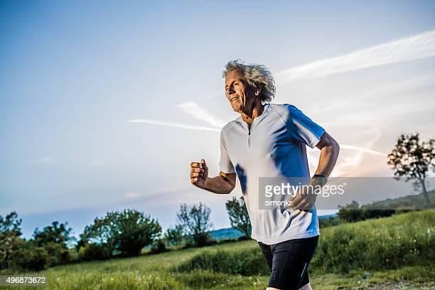 Senior man jogging in park