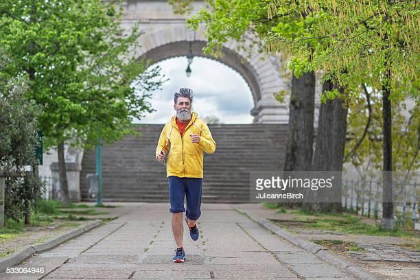 Senior man jogging in the park