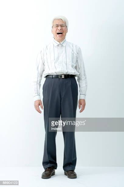 Senior man laughing, full lenght, portrait