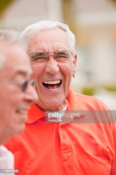 Senior man laughing with his friend