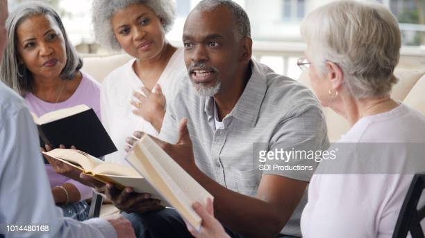 Senior man leads outdoor Bible study