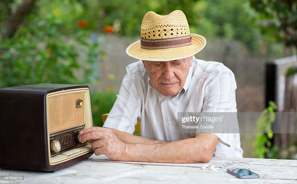 Senior man listening radio : Stock Photo