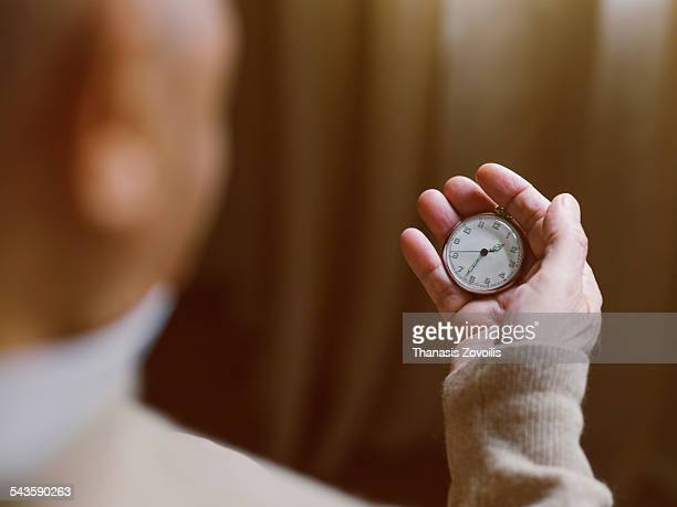 Senior man looking at a vintage watch