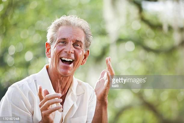 Senior man looking at camera