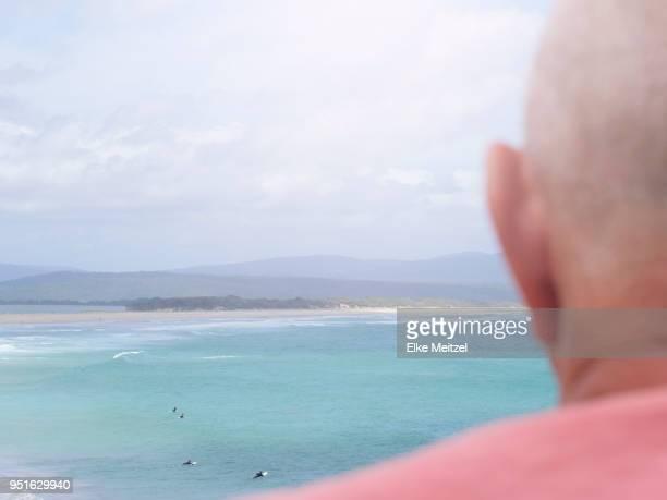 senior man looking at coastal view, rear view, mallacoota, victoria, australia - mallacoota stock pictures, royalty-free photos & images