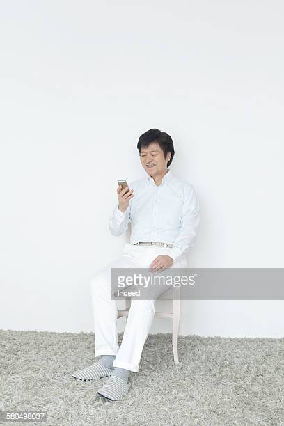 Senior man looking at mobile phone