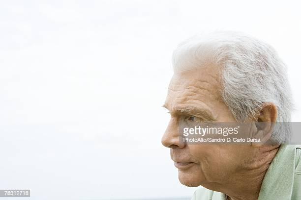Senior man looking away, profile
