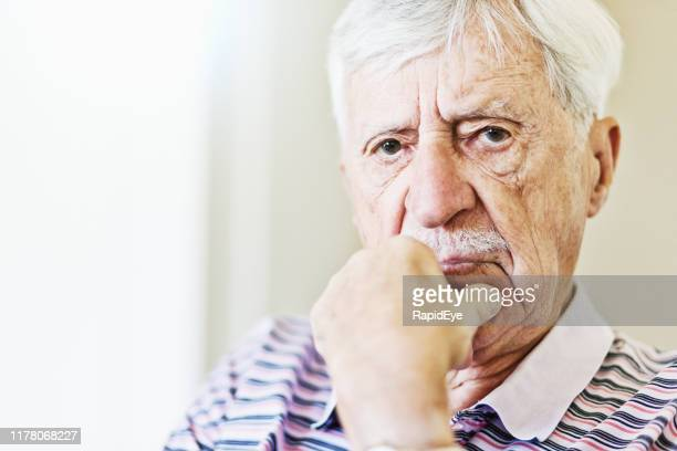 senior man looking worried, chin on hand - grumpy old man stock pictures, royalty-free photos & images