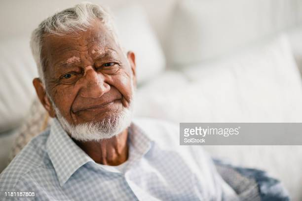senior man looks into camera - 80 89 years stock pictures, royalty-free photos & images