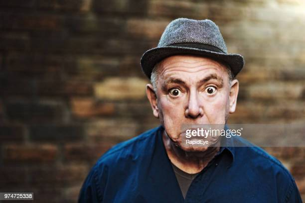 senior man looks shocked - surprise stock pictures, royalty-free photos & images
