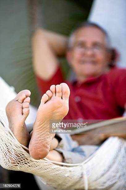 senior man lying on hammock focus feet - old man feet stock pictures, royalty-free photos & images