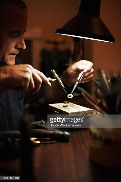 senior man making a ring - jeweller stock photos and pictures