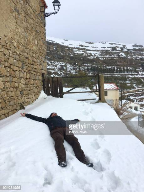 Senior man making a snow angel