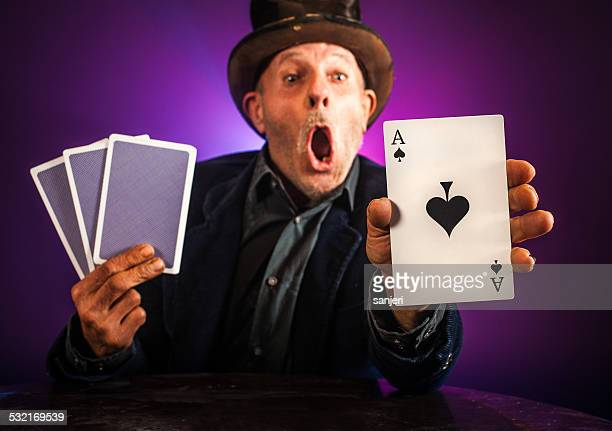 Senior man making trick with playing cards