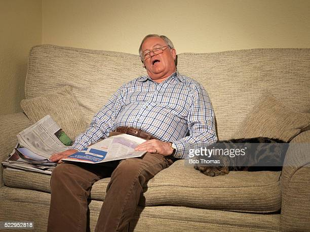 Senior Man Napping on Couch