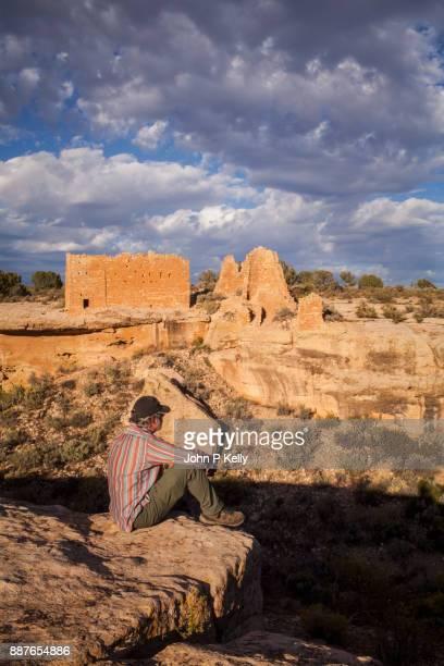 Senior man observing Hovenweep Castle Ruins in Utah