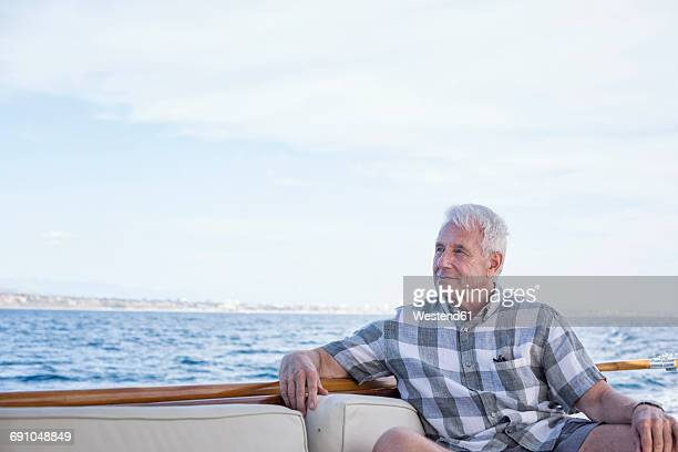 senior man on a boat trip - rich old man stock photos and pictures