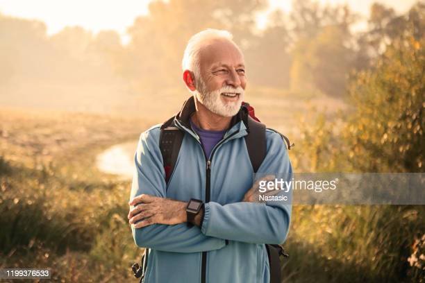 senior man on a footpath - three quarter length stock pictures, royalty-free photos & images
