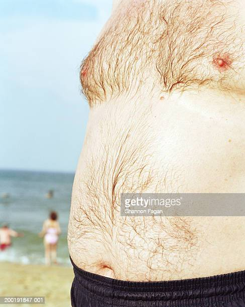 senior man on beach, mid section, close-up - hairy chest stock photos and pictures