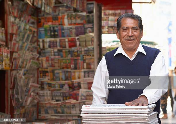 senior man on newspaper  stand in street, smiling, portrait - kiosk stock pictures, royalty-free photos & images